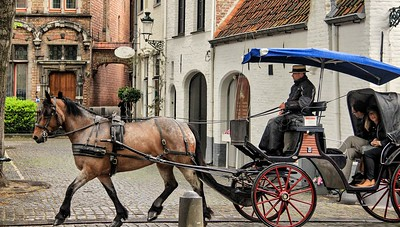 I used the carriages a lot to frame shots and found myself scouting for a quick composition every time I heard one coming. Bruges, Belgium