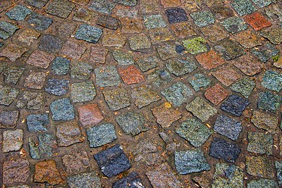 Multi-colored stones in the streets of Bruges, Belgium