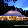 A Cape Cod wedding tent lite up at night at Highfield Hall.