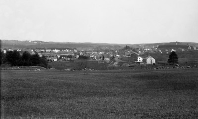 This is looking in the direction of Derry Depot from a location north of where Exit 4 now is.  On the far left at the horizon is the East Derry Meeting House.