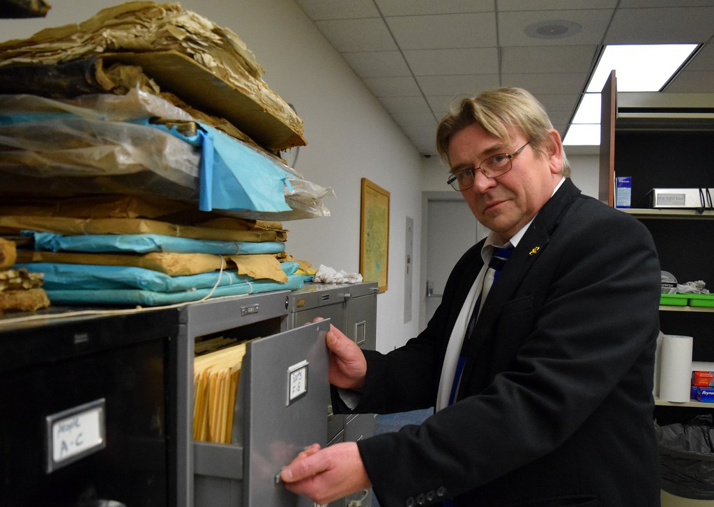 . Stephen Weiter, dean of the Oakland University Libraries, stands before a row of filing cabinets containing an unknown mass of printed historic photographs from The Oakland Press at the Kresge Library at Oakland University on Tuesday, Dec. 12, 2017.