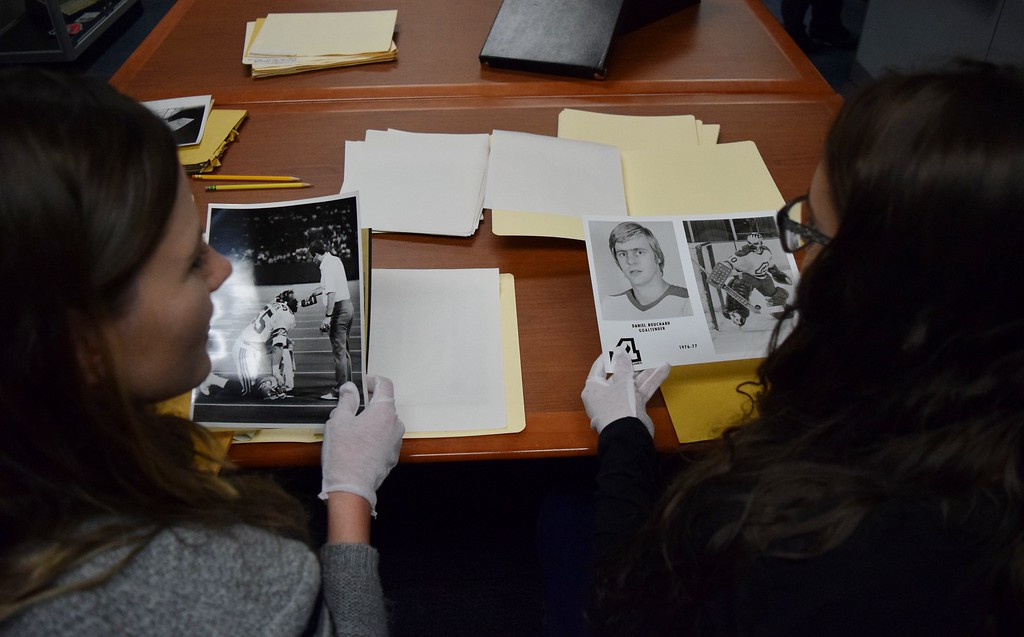. Lauren Spencer (left), first-year doctorate of physical therapy student, sifts through historic photographs from the Oakland Press special collection with Elizabeth Deneen, marketing major, at the Kresge Library at Oakland University on Tuesday, Dec. 12, 2017.