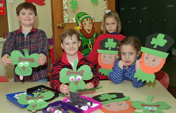 98/03/16 St. Patrick Posters *Dennis Stierer photo - These children at DeSales Catholic school made some cutouts to hang on the walls and doors. From left are Stephen Smith; David Connolly, Rebecca Roskopf; and Miller Barmasse