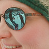 98/01/17-- winterfest 3--Takaaki Iwabu photo-- Bonnie Thompson wears  a shade which reflects her family members (Patrick; husband, Justin and Alyssa; children) enjoy sledding  on the top of the hill at Bond Lake County Park Saturday. The Thompsons is from Lewiston. <br /> <br /> grapevine photo