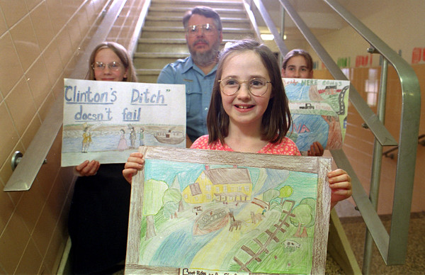 98/06/03 Canal Poster Winners-Rachel Naber photo-(clockwise) Eileen Horgan, 2nd place, Caitlin Miller, 3rd place, Marty Busch, canal task force chairman, Alexis Draper-Pask, 1st place at Oak Orchard Elementary School.