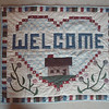 97/10/01 Quilters 4 - James Neiss Photo - Pieced and Applique Welcome Wall hanging quilt.