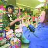 1/17/97 2 Jobs - James Neiss Photo - Stacey Pickett of NF serves Nanette Broeker of NF at Wilson Farms at Niagara and 4th st..  Pickett has to work 2 jobs to make ends meat.