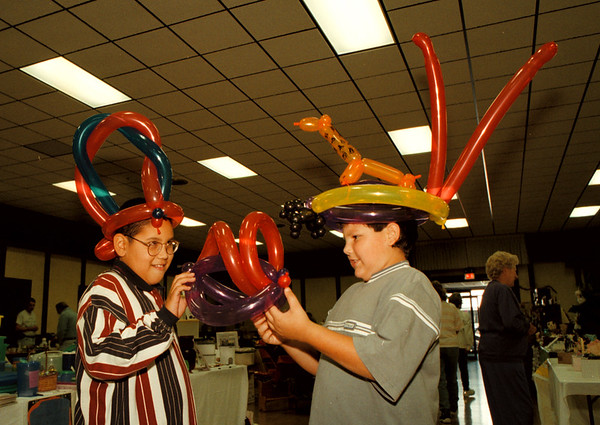 98/10/04 Balloon Hats *Dennis Stierer Photo - GrapeVine<br /> Juan Ulloa of Lockport, and Chris Brant of Ransomville were admiring each others balloon hats that were made for them at the Cambria Fire Hall during a craft show and chowder sale.