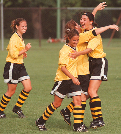 97/09/09 girls soccer 2--takaaki iwabu photo-- LaSalle HS players celebrate in midfield after the team's score against Niagara Falls HS.