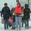 97/12/1--WEATHER/DETAIL--DAN CAPPELLAZZO PHOTO--NIAGARA STREET SCHOOL CROSSING GUARD TERRI GRANIERI HOLDS BACK  STUDENTS AND PARENTS DURING HEAVY SNOW FALL WEDNESDAY AFTERNOON AT THE NIAGARA STREET SCHOOL.<br /> <br /> 1A