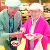 98/06/05 Here's A Spoon *Dennis Stierer Photo - Donal Ames hands his wife Betty a spoon so they can enjoy the strawberry shortcake at the Lockport Historical Society's annual festival. Donald is the Youngstown Historian.