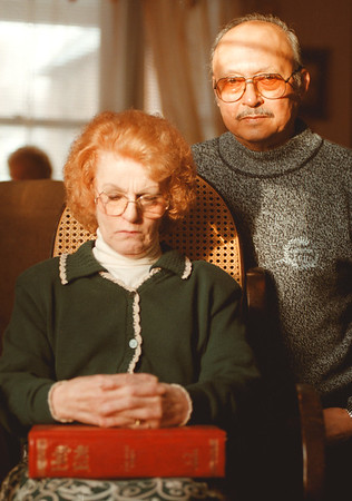 "98/01//02--FLIM FLAM/SCAM--DAN CAPPELLAZZO PHOTO--DOROTHY AND ROETH ""BOB"" LIZARDO SIT IN THEIR WHITNEY AVE HOME. THE LIZARDO'S WHERE BILKED OUT OF A 1/4 MILLION $$$$$ BY JOHN T. FORTIER. MRS LIZARDO, WHO IS A MINISTER AT CHURCH ON THE ROCK, PINE AVE. SHE SAID THAT PRAYER HAS HELPED THEM THROUGH THIS TOUGH TIME.<br /> <br /> 1A SUNDAY"