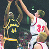 3/2/96--LaSalle 1--Tak photo--LaSalle's Damien Watson aims a basket as Lancaster's Shawn Zaffram trys to block it.
