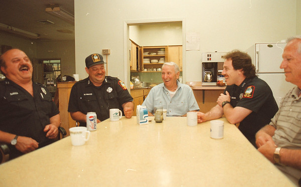 6/19/97--HEART ATTACK SURVIVOR--DAN CAPPELLAZZO PHOTO--(LTOR) CHESTER HYLA, OF GRIFFIN ST., CENTER WITH CIVILIAN SHIRT, SPEAKS WITH BOLLIER FIRE STATION CAPT. BART DeROSA, WILLIAM MAYES EMDT WHO REVIVED MR HYLA. PAUL BARR, WHO ASSISTED WITH RESCUE AND HYLA'S NIEGHBOR/RETIRED NF FIRE CAPT. KENNETH BOWSER. MEET AT THE BOLLIER ST FIRE HALL TO RECOUNT THE EVENTS OF THAT DAY.<br /> <br /> GR