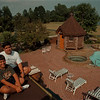 98/08/11- Garden 6--Takaaki Iwabu photo-- Tony Elia, 9, left, sits on his houseÕs roof with his cousin Omar Salomom. TonyÕs parents, Larry and Samia Elia own a beautiful property (with garden, pool and pont!)  in Wilson. <br /> <br /> Sunday/Feature