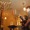 98/12/10 Temple Beth - Vino Wong Photo - Ryan, 3, and Justin Taylor, 8, stand by the candleabrum use for the Jewish festival of lights which begins December 13th through the 21st at the Temple Beth El, 720 Ashland Street.
