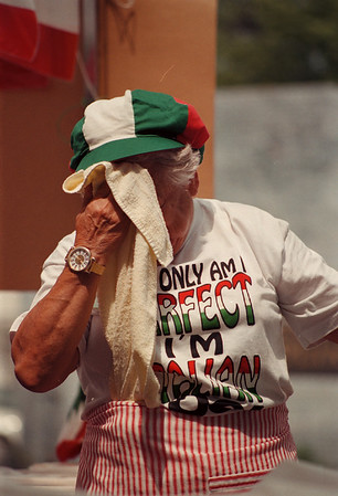98/08/09 Italian Fest Weather-Rachel Naber Photo-Phyllis Mussari takes a moment  between serving cups of coffee and ice tea in the St. JosephÕs Senior Society Boooth at the italian festival to sponge the sweat from her face.