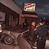 97/11/03--COM0 MVA--DAN CAPPELLAZZO PHOTO--NF POLICE AND AMBULANCE CREW HELP A DRIVER, WHO DROVE INTO THE FRONT OF THE COMO RESTAURANT ABOUT 5:40 PM, OUT OF HIS CAR.<br /> <br /> 1A FOLDER