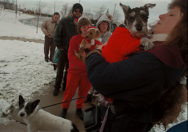 """97/12/12-- SPCA/Xmas--Takaaki Iwabu photo-- Sherrie Schroeder, Town of Wheatfield, holds her Miniture Schnauzer """"Gretchen"""" as she and other dog owners lined up for the picture with Santa Clause at SPCA's Christmas party Sautrday. <br /> <br /> local, color, Sunday"""