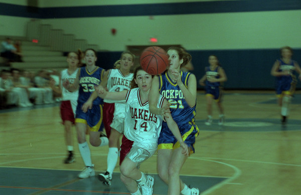 98/02/28 Lady Lion's Win *Dennis Stierer photo -  Kate Pace #14 of Orchard Park tries to block a pass to Larissa Croff #21 of Lockport during Saturday's semi-final match-up. Lockport goes on to win the game.
