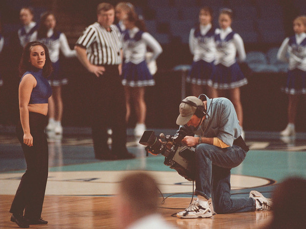 98/02/05--Mike Bird 2-- Takaaki Iwabu photo-- Mike Bird follows the action of NU dance team during the basketball game.... for Bill's feature on a local TV photographer.