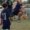 7/27/97--SOCCER 2--DAN CAPPELLAZZO PHOTO--6-YR-OLD SAMANTHA McGARVEY, OF THE PANAMA TEAM, LEAPS OFF THE GROUND AFTER A THROW IN  DURING GAME ACTION.<br /> <br /> FEATURE