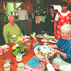 7/23/97--PARENTHOOD 2--DAN CAPPELLAZZO PHOTO--HOST  BETSY DIACHUN PASSES A FRUIT SALAD AROUND THE TABLE AT THEIR HOME IN WILSON  FOR A BENEFIT MEAL FOR PLANNED PARENTHOOD