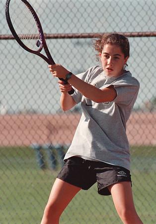 97/09/08-- HS tennis--Takaaki Iwabu photo-- Lasalle High School Miranda Snyder returns the serve against Lockport HS Kristen VanSchoonhoven.<br /> <br /> Sports, Tuesday, color