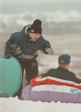 98/01/17-- Winterfest --Takaaki Iwabu photo-- Tim Walter, 15, bursts into a laughter as he enjoys sledding with his friend on the top of hill at Bond Lake County Park in Lewiston. <br /> <br /> local, color, Sunday