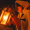 97/12/12 Candle Tour 2--Takaaki Iwabu photo-- Steve Andrews, a re-enactor at Fort Niagara, lits a candles beside a Christmas tree in French Castle Friday as he prepares for Candle Light Tour at Fort Niagara.