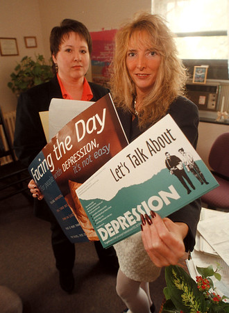97/10/03 Depression Clinic - James Neiss Photo - L-R - Barbara M. Burns, Director of Education, information and self help at the Mental Health Association in Niagara County, Inc. and Paige Glynn, CSW Staff Social Worker at the Niagara county Dept. of mental Health, Alcohol & Drug Abuse, prepare for National Depression Screening Day.