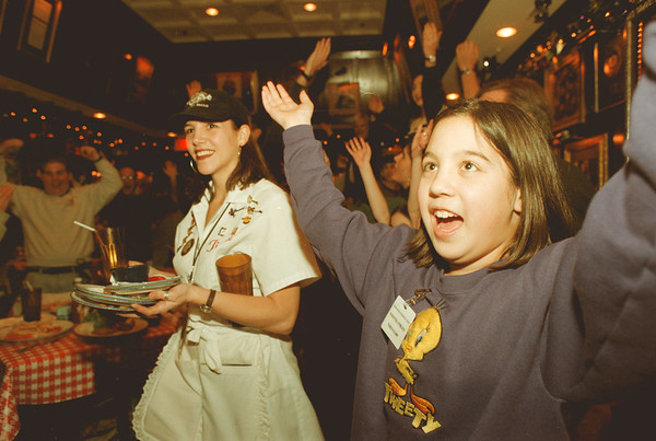 """97/12/05--Good days/S Times--Takaaki Iwabu photo-- Samantha Poblete, 10, Amharst, sings """"YMCA"""" with other participants of Campers Good Days and Specail Times as they dined Hard Rock Cafe Niagara Falls Friday night."""