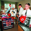 2/19/97 Niagara Catholic Auction - James Neiss Photo - Getting things together for the Niagara Catholic Jr./Sr. High School Variety Auction are: L-R- Ronald Buggs President/Principal, Lenny Bevilacqua 16/11th and Tom Olson 15/10th. Lot's of sports items up for grab.