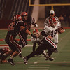 98/11/06 Clarence VS NW 2 - James Neiss Photo - Niagara Wheatfields Quarter Back #19 Jason Herman, plays keep away from the Clarence defenders during the first qtr of the Section VI class A Championship Game at Rich Stadium