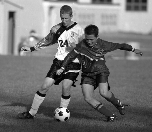 98/10/06 Boys Soccer #2 *Dennis Stierer Photo - B/W<br /> Lyndonville's #24, Dan Hogan tries to get the ball first as Medina's #2,Jacob Ihbe sneaks in to get the kick.