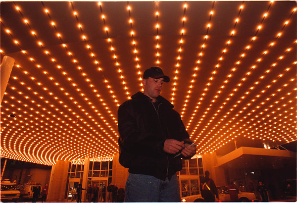 12/9/96 - Casino - Cappy Photo - Dustin Citron, of Buffalo, NY, counts his winnings under the grand marquee of Casino Niagara. Citron spent $100 and won $300 playing Black Jack.