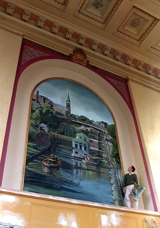98/04/02 Watkin's Mural *Dennis Stierer photo - Jeff Watkins, an artist and sign painter,  looks over the finished mural he has done for the lobby of the Lockport Exchange Bank building at Main and Pine in Lockport. The finished mural is about 13.5 feet wide by 22 feet high.