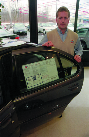 """98/1/30 Auto Lease Nissan-Rachel Naber Photo-Terance Riordan, general manager of Nissan Lockport with the Ultima the companies best leasted car to customers that are """"young, have small families, and are value orientated."""""""