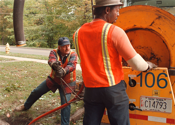 97/10/01--- maintenance --Takaaki Iwabu photo-- Niagara Falls City worker Jim Maietta, left, and Bruce Palmer from Outside Sewer Maintenance Dept. clean up sanitary sewer line on Pershing Avemue Wednesday. A dozen of City workers keep the area's sewers functioning. <br /> <br /> Grapevine photo