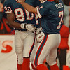 98/11/01--BILLS/MOULDS/FLUTE JUBO--DAN CAPPELLAZZO PHOTO--BILLS QB DOUG FLUTE AND ERIC MOULDS CELEBRATE AT 45YD TD PASS IN THE 4TH QUARTER WHICH BROUGHT THE BILLS WITHIN 3.