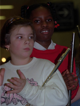 1/20/97--MLK DAY/NFCC--CAPPY PHOTO--9-YR-OLD HANNAH BOROWICZ (FRONT) AND FELLOW NIAGARA ST. SCHOOL BAND MEMBER MARQUETTA WYNN, 9, APPLAUD  DURING MLK DAY CEREMONY AT NFCC. BOTH GIRLS ARE 4TH GRADERS AT THE NIAGARA SCHOOL.<br /> <br /> 1A