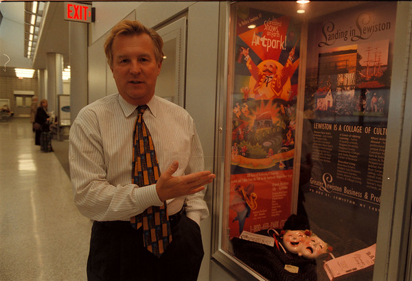 11/14/97--development, 2--Takaaki Iwabu photo-- Bob Rakuczy of aviation business development at Buffalo-Niagara International Airport, shows the display case that features the information of Lewiston at West Wing of the Airport. <br /> <br /> tmc photo