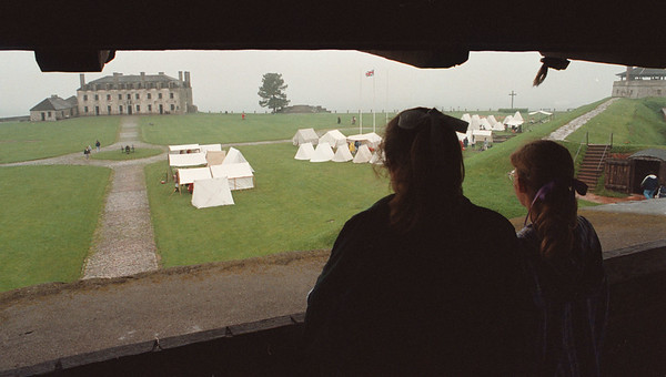 6/1/97--FT. NIAGARA--DAN CAPPELLAZZO PHOTO--(LTOR) 12-YR-OLD HANNAH VORCE AND HER 9-YR-OLD SISTER REBECCA, BOTH OF TENNESSEE, LOOK OUT OVER THE FT NIAGARA BRITISH ENCAMPMENT  ROYAL BIRTHDAY CELEBRATION.<br /> <br /> LOCAL