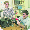 1/10/97 Heating $ Cooling - James Neiss Photo - L-R - Nick Johnson, of LewPort HS 16/11, and Rich Silvaroli 26, a returning student, both participate in the Boces Heating and Cooling Course which has proven to be recruted by local employeers.