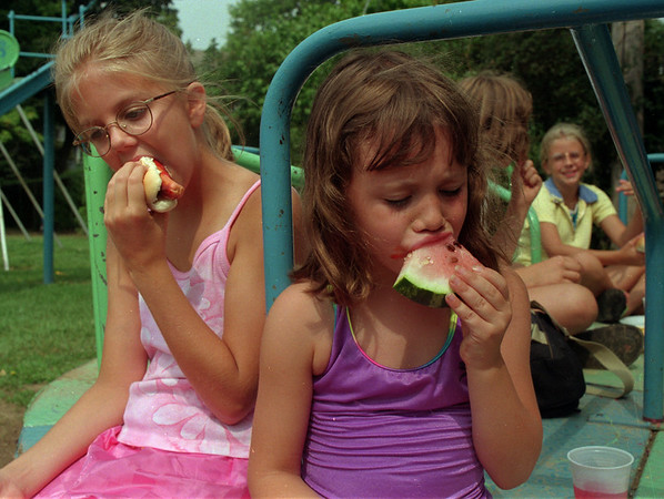 98/08/10  Park Picnic *Dennis Stierer Photo - <br /> Pine Street Park held a picnic on Monday for the Park Program Kids and Emily Dunham, 10 and Elizabeth Touley, 6 enjoy some hot dogs and watermelon.