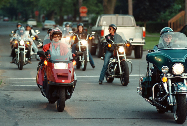 6/22/97--W bikers 1--Takaaki Iwabu photo-- Local women bikers stroll down the street in North Tonawanda. <br /> <br /> Sunday, living, color