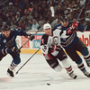 4/13/97--SABRES HOCKEY--DAN CAPPELLAZZO PHOTO--BUFFALO SABRES BRIAN HOLZINGER IS CHASED BY THE WASH. CAPS (LEFT)SERGEI GONCHAR AND MIKE EAGLES IN FIRST PERIOD ACTION.<br /> <br /> SPORTS