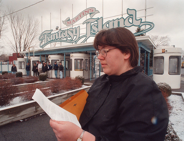 3/22/97 Fantasy Island - James Neiss Photo - Stacey Wasieczko 21yrs, of the town of Niagara, takes a last look at her resume before doors open for the  Fantsy Island Job fair.