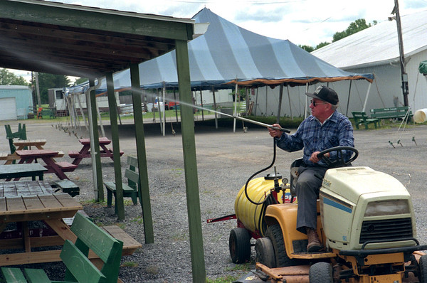 98/07/24 Go Away Flies *Dennis Stierer Photo -<br /> Clarence Preston, a 4-H volunteer is sraying for mosquitoes and flies in hopes of cutting down on the population during the Fair which opens this Tuesday.