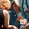 6/19/97--ART PICNIC--DAN CAPPELLAZZO PHOTO--WEARING A 100-YR-OLD HAT MADE BY HER MOTHER AND SAVED FOR SPECIAL OCCASIANS 78-YR-OLD JEAN HACKENHEIMER, OF N.F., SPEAKS TO JACKIE MOYER OF KENMORE. AT THE NIAGARA COUNCIL FOR THE ARTS PICNIC AT CARBO. CENTENIAL PARK.<br /> <br /> LOCAL